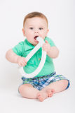 Baby Holding Letter D and Chewing Royalty Free Stock Photo