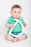 Baby Holding Letter D Looking Right Royalty Free Stock Photography