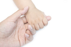 Baby holding mom's finger Stock Image