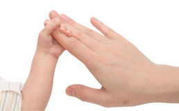 Baby Holding Mothers hand Stock Image