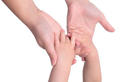 Baby holding mothers hands Royalty Free Stock Image
