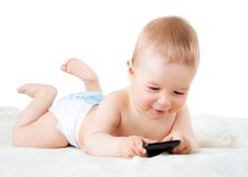 Baby holding a phone Royalty Free Stock Images