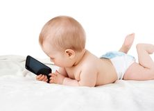 Baby holding a phone Royalty Free Stock Image