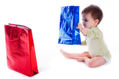 Baby holding the shopping bag Stock Photos