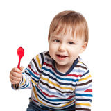 Baby holding spoon Royalty Free Stock Images