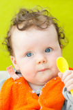 Baby holding spoon Stock Images