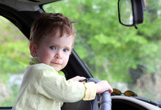 Baby holding steering wheel Stock Images