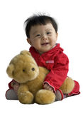 Baby holding toy bear isolated