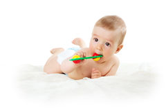 Baby holding a toy Royalty Free Stock Images