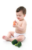Baby holding vegetables Royalty Free Stock Photo