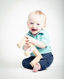 Baby Holding Wooden Letter E Smiling Royalty Free Stock Images