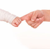 Baby holds mother's finger, trust family help concept Royalty Free Stock Images