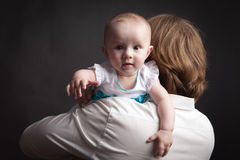 Baby holds out his hand to the camera Royalty Free Stock Photo