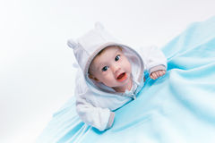 Baby in the hood on a blue blanket Royalty Free Stock Images