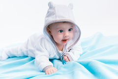 Baby in the hood on a blue blanket Royalty Free Stock Photo