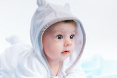 Baby in the hood on a blue blanket Stock Photography