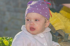 The baby in the hood cries, closeup. Closeup of a baby cries large tears Royalty Free Stock Photos