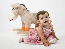 Baby with a horse. Is a baby with a stuffed horse Royalty Free Stock Photos