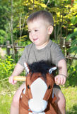 Baby and horse Stock Image
