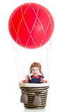 Baby on hot air balloon Stock Photos