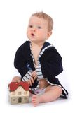Baby with house model Stock Photos