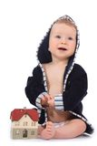 Baby with house model Stock Images