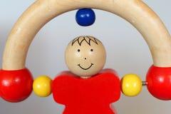 Baby houten stuk speelgoed - rollende mens Royalty-vrije Stock Afbeeldingen