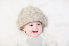 Baby in a huge knitted hat Royalty Free Stock Photography