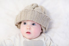 Baby in a huge knitted hat Royalty Free Stock Images