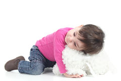 Baby hugging a teddy bear. On a white isolated background Stock Photography