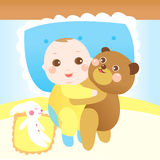 Baby hugging teddy bear on the bed Stock Images