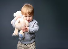 Baby hugging teddybear Stock Photography