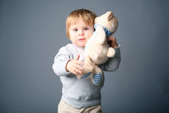 Baby hugging teddybear Royalty Free Stock Image