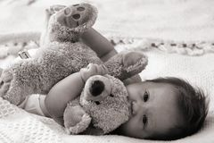 Baby hugging teddybear Royalty Free Stock Photo