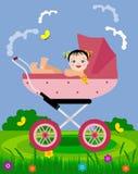 Baby im Pram auf einem Weg Stockfoto