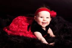 Baby im roten Kleid Stockbilder