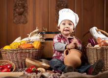 Baby In A Cook Cap Royalty Free Stock Image