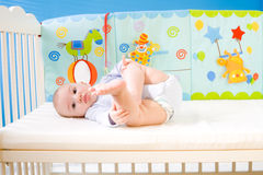 Baby In Bed Stock Image