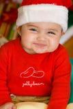 Baby In Christmas Cloths Stock Photos