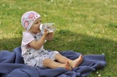 Baby In Garden Stock Image