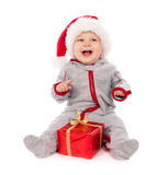 Baby In Santa Hat Playing With Christmas Gift Box Royalty Free Stock Images