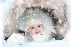 Free Baby In Stroller In Winter Snow. Kid In Pram Stock Photography - 200116792