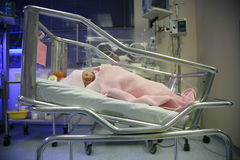 Baby in an incubator sleeping