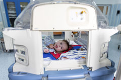Baby in an incubator smiling Stock Photography