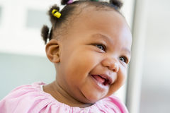 Baby indoors laughing Royalty Free Stock Photo