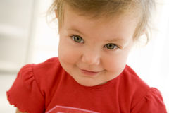 Baby indoors smiling Stock Image