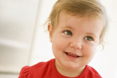 Baby indoors smiling Stock Photography