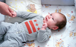 Baby in infant bed Stock Image
