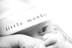Baby Infant Boy. Infant boy wearing a white hat Royalty Free Stock Photography