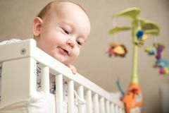 Baby infant boy in his bed. Standing portrait Stock Images
